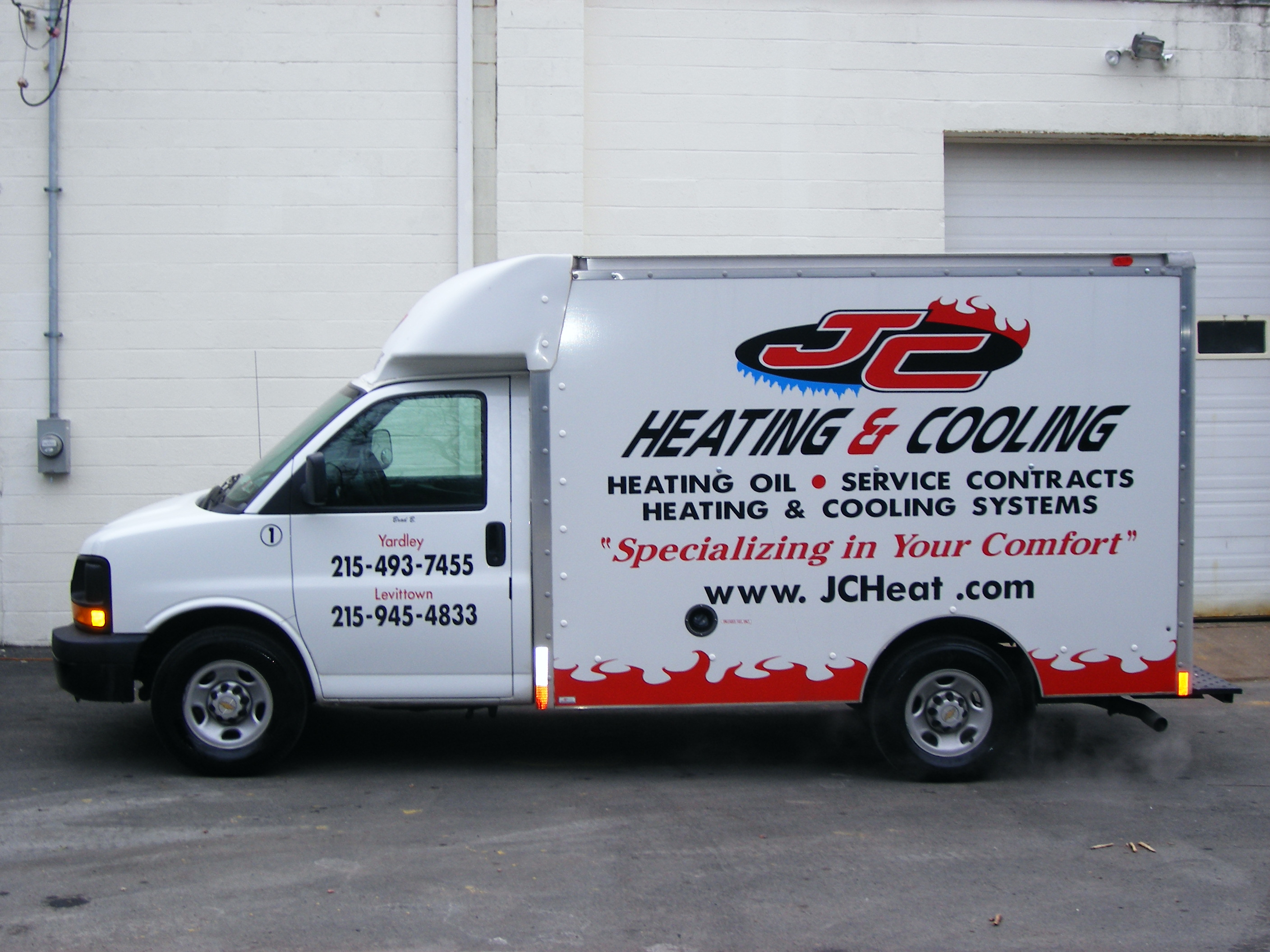 JC Heating radio dispacted service van